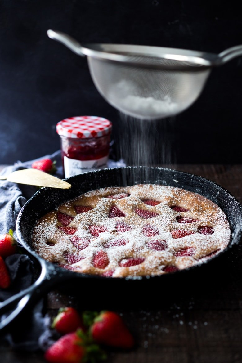 Strawberry Skillet Cake- a spring treat that can be served for breakfast or dessert! GF Adaptable. | #cake #strawberry #strawberrycake #skilletcake #breakfastcake www.feastingathome.com