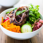 Burger in a Bowl- grilled ( beef, lamb, turkey or veggie) burger served over a mound of greens with fresh veggies and your choice of dressing. A tasty healthier way to serve a burger! | www.feastingathome.com