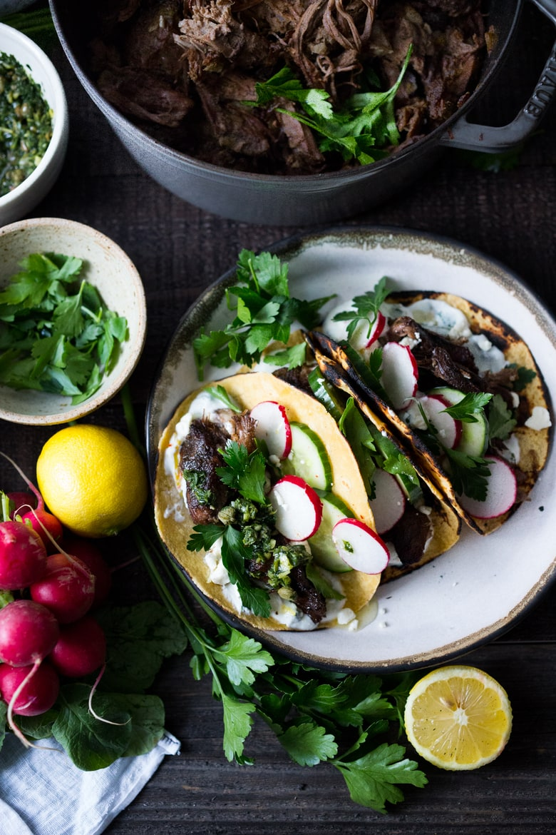 Greek lamb Tacos with Minted Yogurt Sauce, cucumber, radish, feta and an herb-caper drizzle- a feast for the senses! | www.feastingathome.com