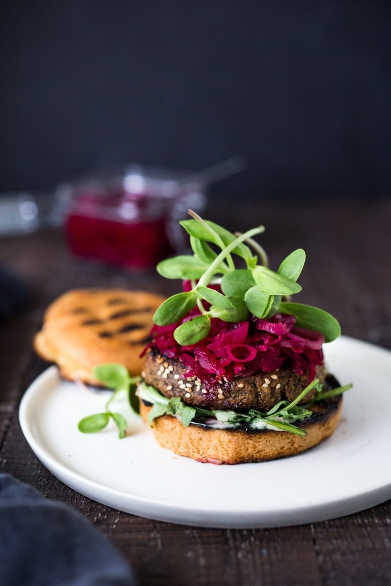 25 BEST Lentil Recipes! | Sprouted Lentil Burgars- GRILLABLE, vegan and gluten free adaptable. Topped with picked beets. | www.feastingathome.com #vegan #burger #grilled