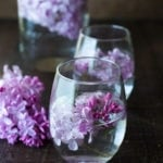 Lilac Water- water infused with lilac blossoms calms and restores the spirit. Perfect for weddings or celebrations, a lovely way to celebrate spring. | www.feastingathome.com #lilacwater #infused #lilacs #lilacrecipes #spring #infusedwater #water