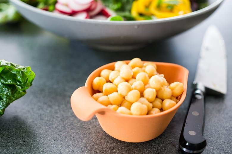 Mediterranean Chard Salad with farmers market veggies, chickpeas and toasted pepitas.   www.feastingathome.com