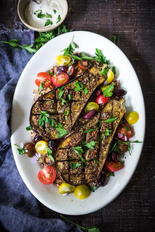 Zataar Roasted Eggplant served over rice or grains with lemony tahini sauce, plain yogurt or tzatzki sauce. Vegan, Gluten-free! | www.feastingathome.com