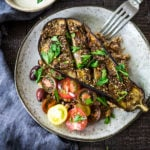 Zataar Roasted Eggplant with fresh tomatoes, tahini or yogurt sauce and cooked grain. A healthy vegan gluten-free meal.
