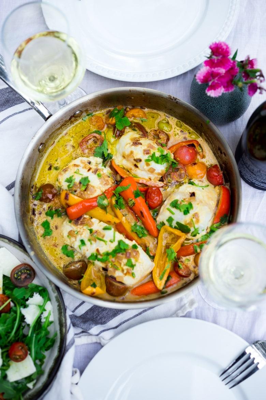 Flavoful and easy Brazilian Fish Stew (aka Moqueca) with coconut milk, chilies, and lime. #fishstew #Brazilianfishstew   www.feastingathome.com