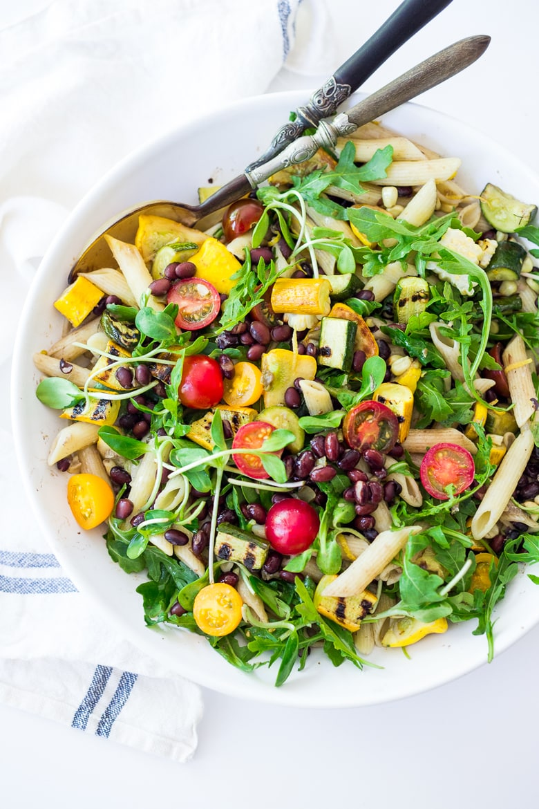 Farmers Market Pasta Salad with grilled zucchini, corn and blackbeans or other veggies! Make with optional grain-free pasta and keep it vegan or add feta. | www.feastingathome.com