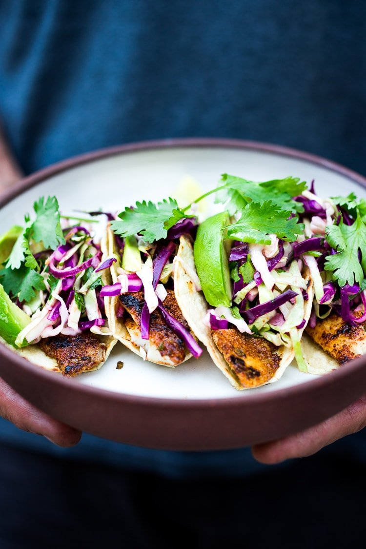 "Simple tasty Grilled Fish Tacos with a delicious Cilantro Lime Cabbage Slaw- a ""go-to"" healthy dinner that be made in 30 minutes flat. 