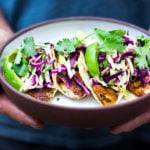 Quick & easy Fish (or Tofu) Tacos topped with Cilantro Lime Cabbage Slaw that can be made using a grill, stove top or oven! Vegan & gluten-free adaptable! A fast and healthy dinner that comes together in under 30 minutes. | #feastingathome #slaw #fishtacos #tacos #grilled #grilling #tacoslaw #cabbageslaw #tofutacos #vegantacos #bakedtacos ##healthytacos #mexicanslaw #mexicanslaw