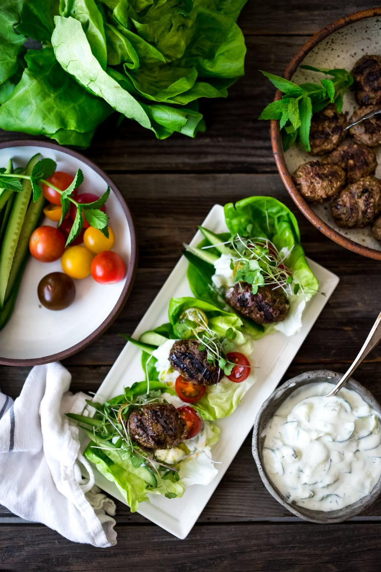 Lamb Kofta Lettuce Wraps served with Tzatziki Sauce! Juicy and delicious, bursting with Middle Eastern flavor! | #kofta #lambkofta #lettucecups #lettucewraps www.feastingathome.com