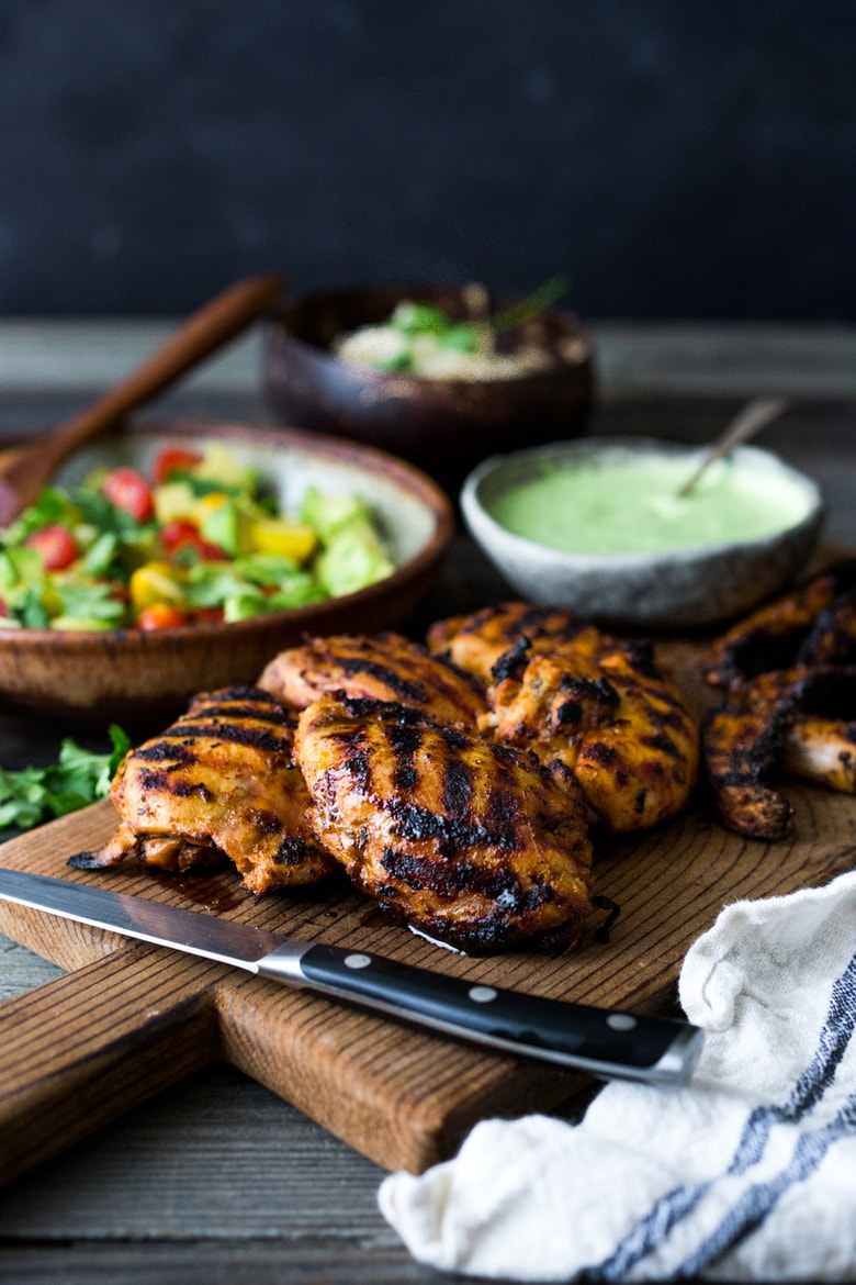 Peruvian Chicken (Pollo a la Brasa) with peruvian Green Sauce and Avocado Tomato Cucumber Salad. Can be made in 40 minutes- perfect for weeknights!