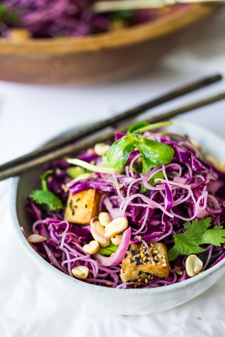 A simple,delicious and healthy recipe for Sesame Cabbage Noodle Salad with rice noodles, scallions cilantro and crunchy roasted peanuts. Vegan, Gluten-free! | www.feastingathome.com