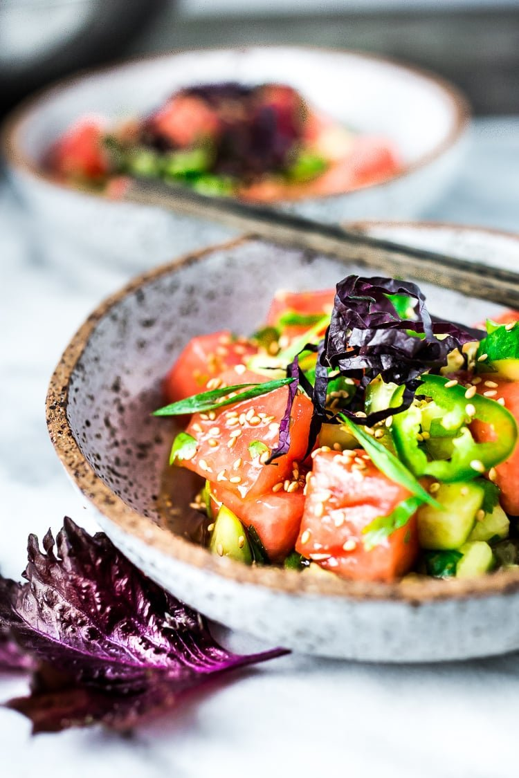 A simple delicious recipe for Watermelon Shiso Salad with Cucumber, Sesame Seeds and Scallions - a light and refreshing Asian style Watermelon Salad that is vegan, gluten-free and full of flavor!#watermelonsalad #shiso #shisorecipe #watermelon
