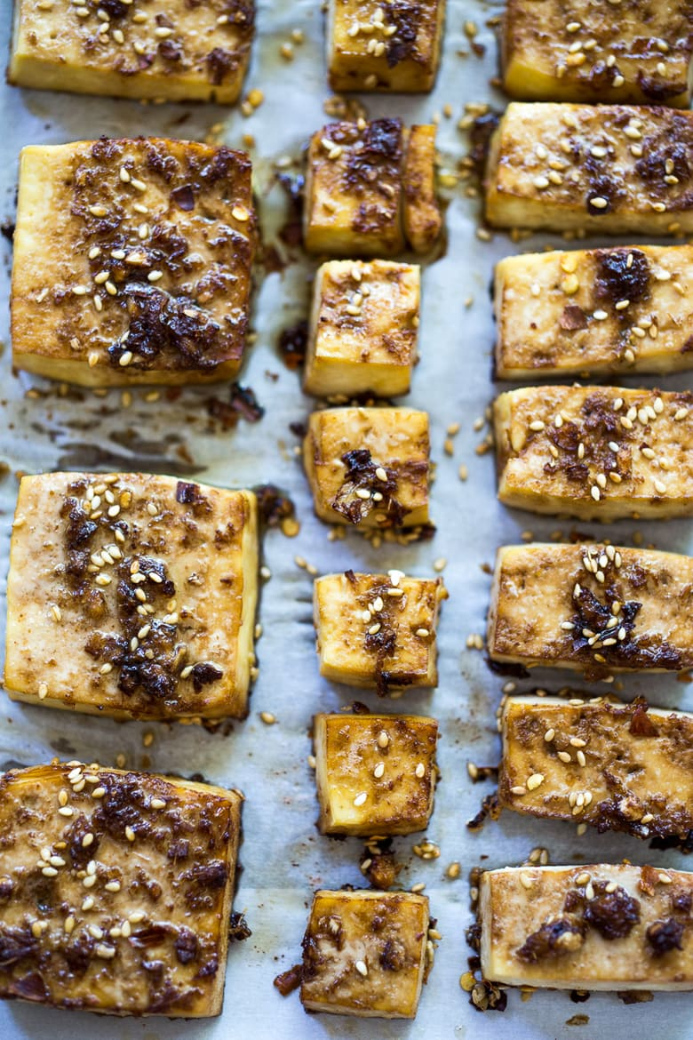 Baked Tofu! With three FLAVORFUL marinades! Never have bland tofu again, with these three variations - Sesame Ginger Miso, Spicy Mexican Tofu and BBQ Tofu. Simple, vegan and easy recipes! Great for meal prep! #bakedtofu #tofumarinade #tofu #howtocooktofu #crispytofu