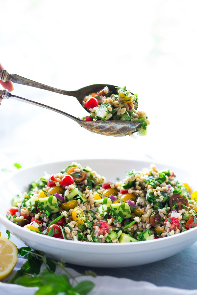 A simple & delicious recipe for Farro Tabbouleh Salad, made with finely chopped vegetables, fresh herbs, lemon and olive oil. Vegan! | www.feastingathome.com