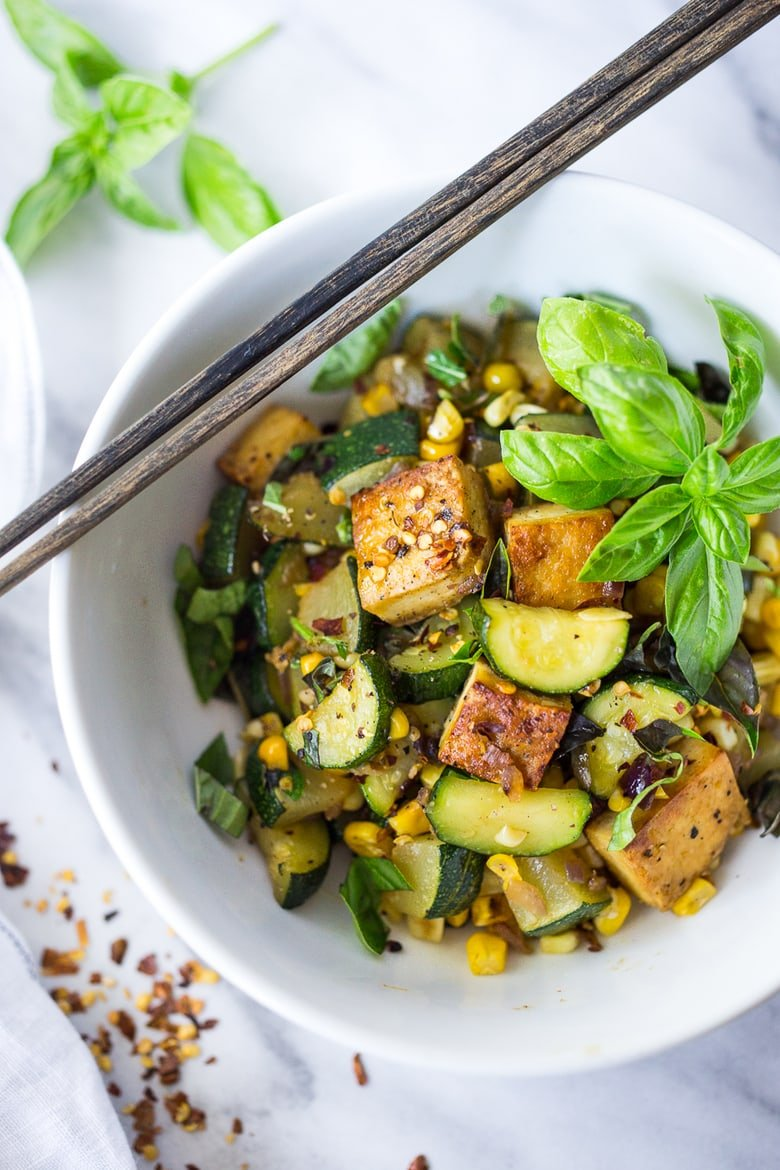 Zucchini, Corn and Basil Stir fry - a healthy easy vegan dinner, topped with your choice of tofu (or chicken or shrimp!) Simple and adaptable. Vegan, Gluten-free! #stirfry #vegestirfry #zucchini #vegan #veganstirfry #easydinner #healthydinner