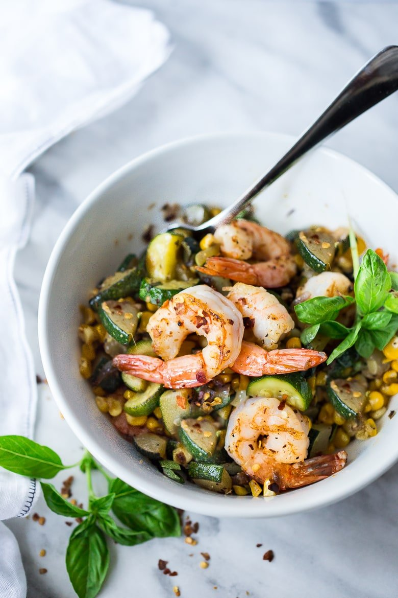 A fast and healthy dinner -Zucchini, Corn and Basil Stir-fry topped with your choice of shrimp, tofu or chicken. Simple and adaptable. Vegan, Gluten-free!
