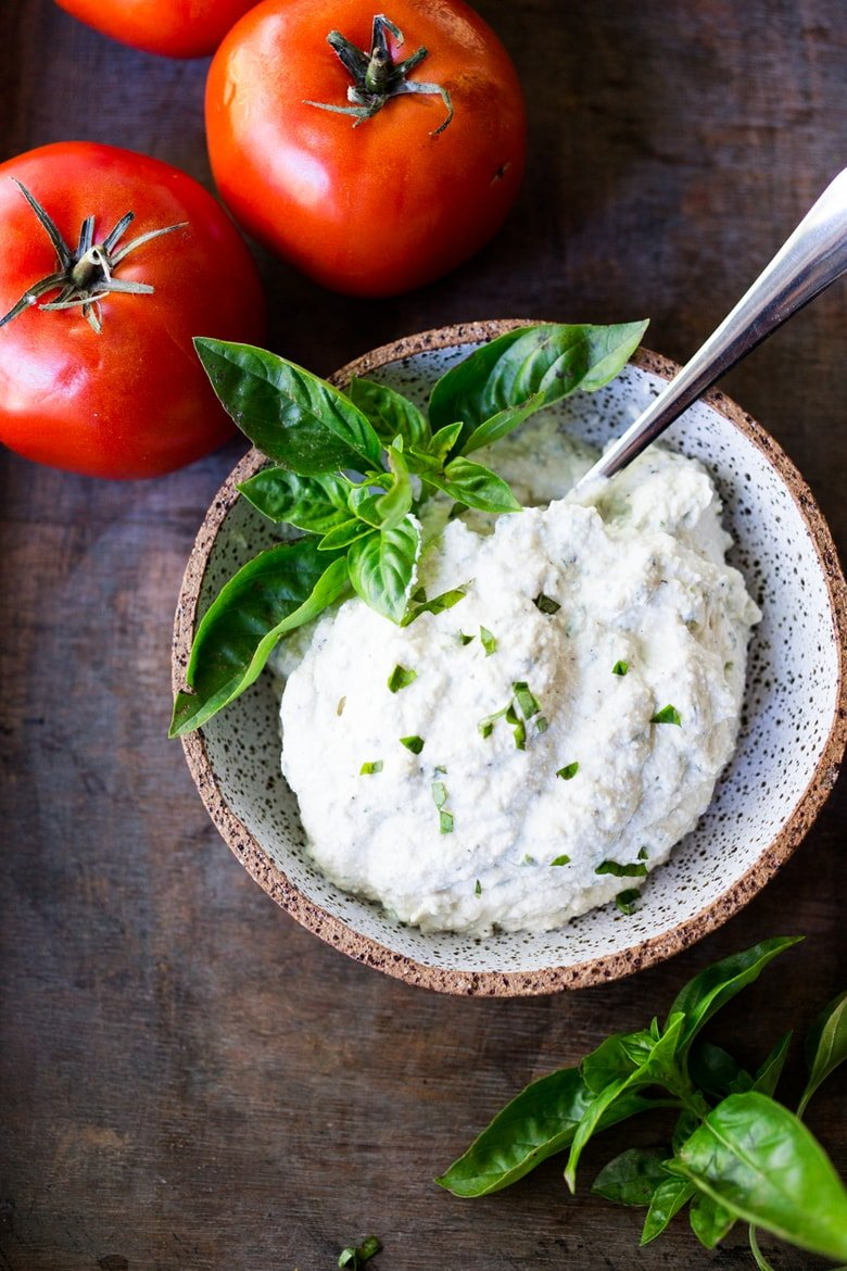 "How to make the BEST vegan Tofu Ricotta - a healthy, nut-free, low calorie, zero cholesterol alternative to ricotta cheese, perfect for lasagna, cannelloni, and other baked dishes where you want a creamy, ""cheesy"" texture.  #vegancheese #tofuricotta #veganricotta #tofuricottarecipe www.feastingathome.com"