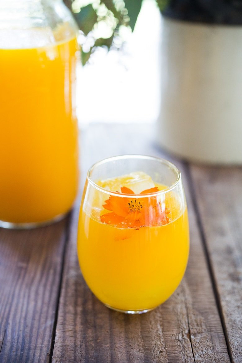 Jamu Juice- Bali's all-natural, anti-inflammatory elixir- made with fresh turmeric, ginger, honey and a squeeze of lemon. Heals and soothes the body! Make a big batch and serve hot or cold during the busy workweek! #turmeric #turmerictea | www.feastingathome.com