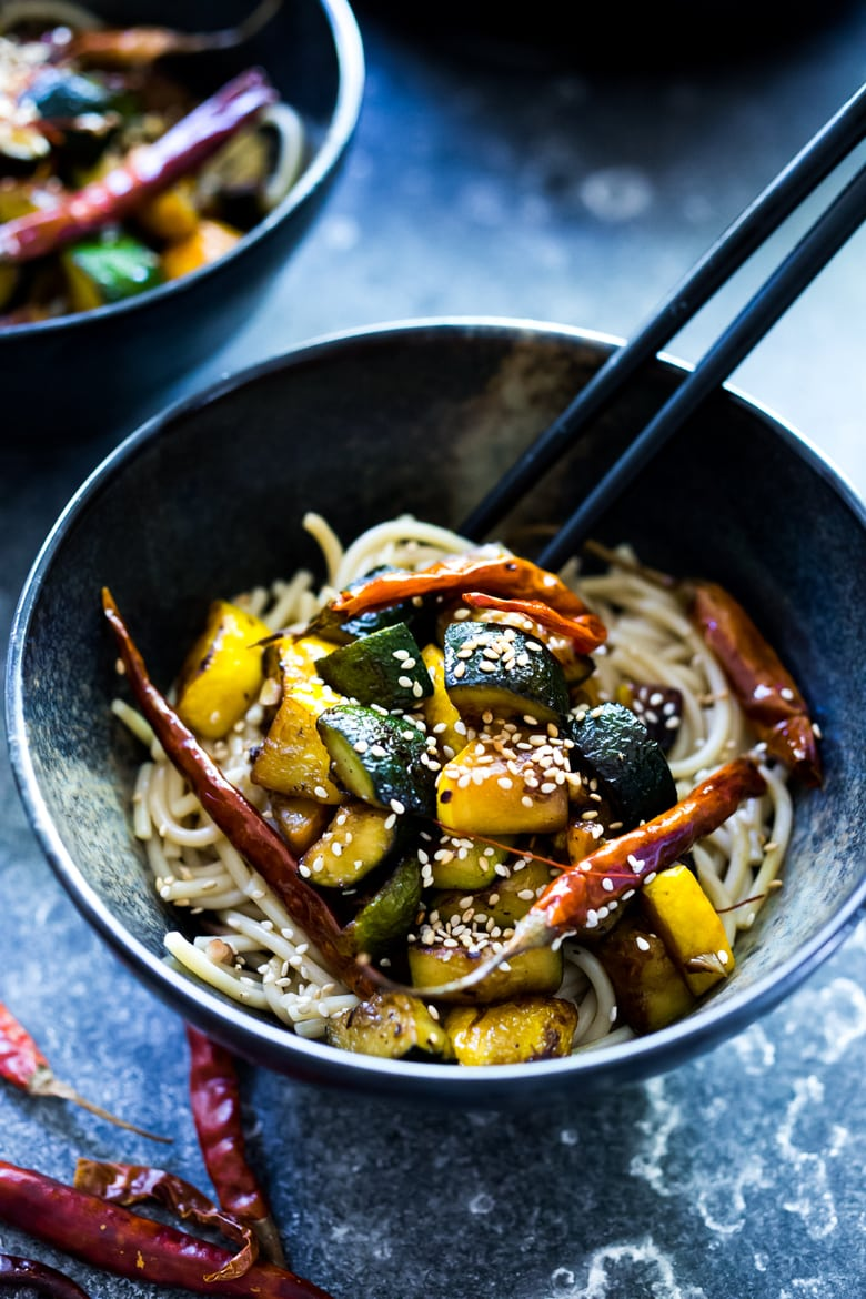 A simple delicious recipe for Kung Pao Zucchini over noodles or rice. Vegan and gluten-free adaptable! | www.feastingathome.com