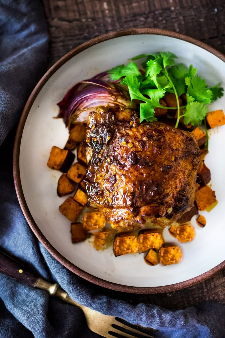 Sheet-Pan Harissa Chicken and roasted Sweet Potatoes- just 15 minutes of hands on time, before baking in the oven. Smoky, earthy, fragrant, North African Spices ! #harissa #harissachicken #chicken # sheetpandinner   www.feastingathome.com