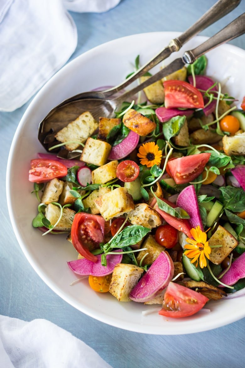 The BEST EVER Summer Panzanella Salad with Garlicky Croutons, bursting with fresh seasonal summer ingredients and FLAVOR!   www.feastingathome.com