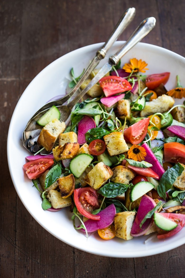 A simple delicious recipe for Summer Panzanella Salad with Garlicky Croutons, bursting with fresh seasonal summer ingredients and FLAVOR! | www.feastingathome.com