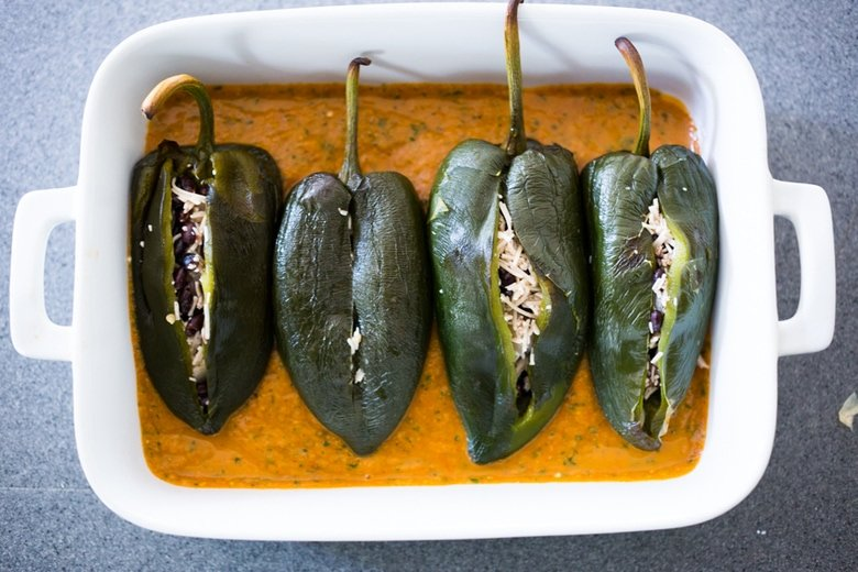 Roasted Black bean Chile Rellenos Recipe- a healthy lightened up version that is roasted instead of fried and is gluten free and vegan adaptable! | www.feastingathome.com