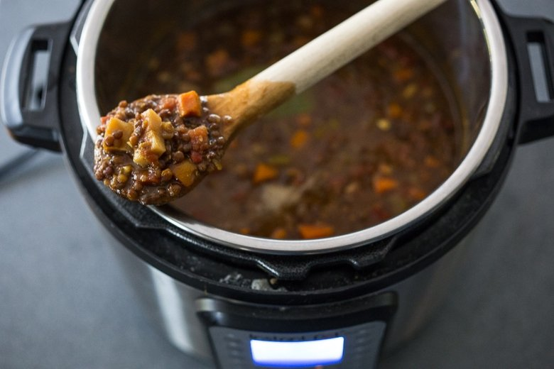 This Middle Eastern - inspired,  Make Life Simple Instant Pot Lentil Soup is vegan and gluten free and can be made on the stove- top or in an Instant Pot in with 12 minutes of cook time! Flavorful and healthy! | www.feastingathome.com #instantpot #lentilsoup #lentils