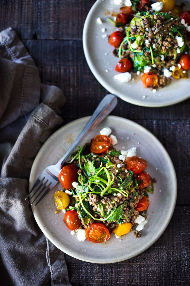 25 BEST Lentil Recipes! Lentils with Blistered Tomatoes and Kale- a simple vegetarian lentil recipe seasoned with Middle Eastern spices & topped with feta. Healthy, tasty! | www.feastingathome.com #halfcuphabit #lentilrecipes #vegetarianlentils