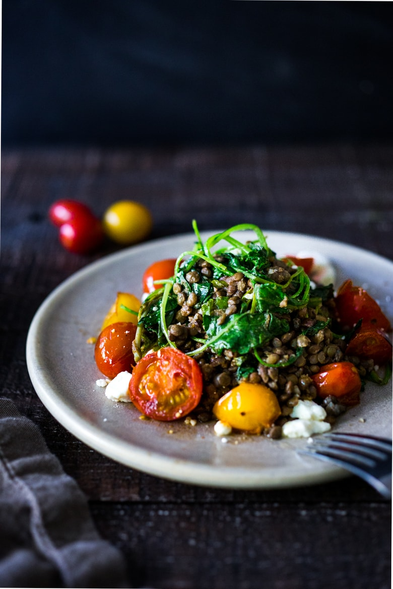 Lentils with Blistered Tomatoes and Kale- a simple vegetarian lentil recipe seasoned with Middle Eastern spices & topped with feta. Healthy, tasty! | www.feastingathome.com #halfcuphabit #lentilrecipes #justaddpulses