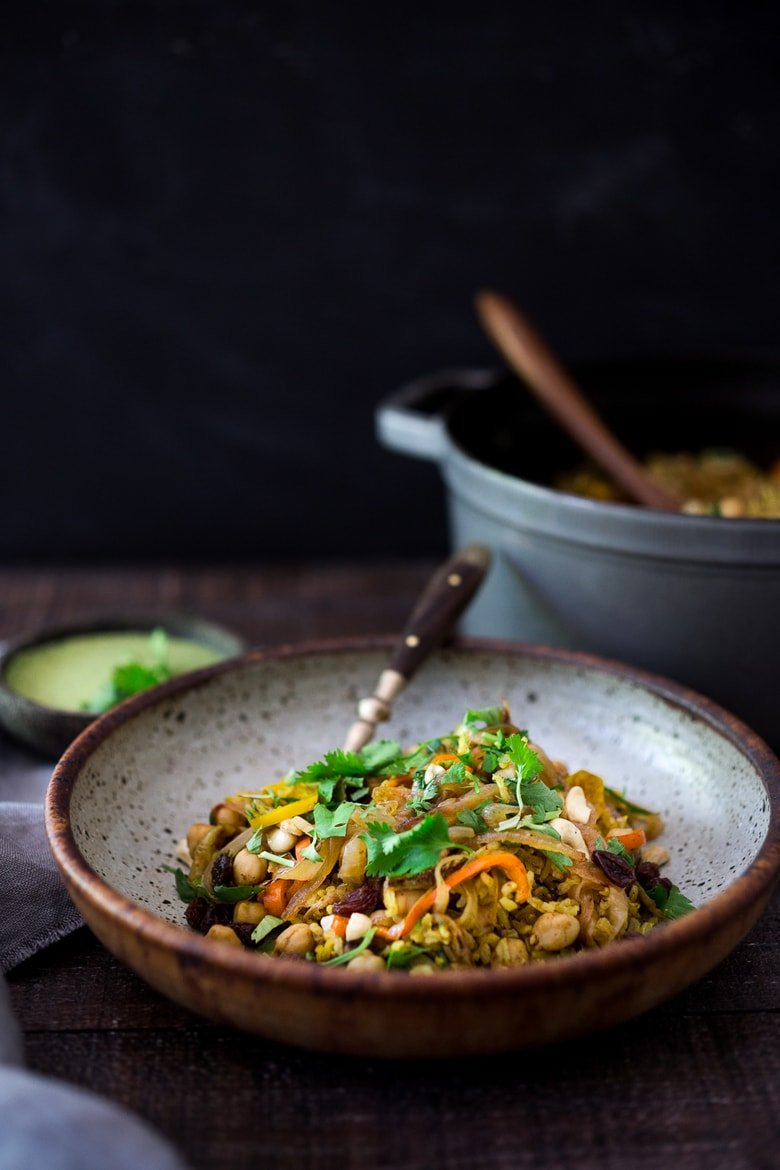 Quick and Easy Vegetarian Biryani! A fragrant Indian rice dish infused with Indian spices - vegan adaptable and gluten-free. A quick and easy weeknight meal. | www.feastingathome.com #biryani #vegandinner #veganrecipe #vegetablebiryani #veganbiryani