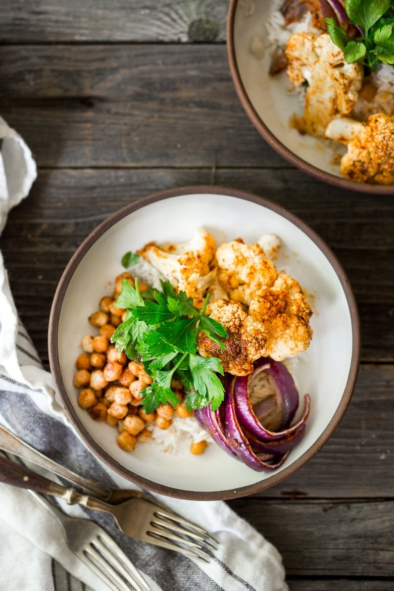 Tandoori Glory Bowl with sheet-pan roasted cauliflower, chickpeas and optional chicken, served over cinnamon scented rice. A FAST, flavorful weeknight meal! Vegan, GF | www.feastingathome.com