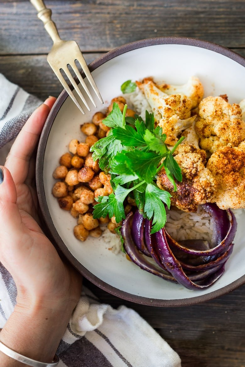 Tandoori Glory Bowl with Roasted cauliflower, chickpeas, (or optional chicken.) Cook it all on one sheet-pan in 30 mins flat! Vegan, GF | #veganbowl #healthybuddhabowl #buddhabowl #vegan #cleaneating #eatingclean #eatclean #detox #cauliflower #healthybowl | www.feastingathome.com