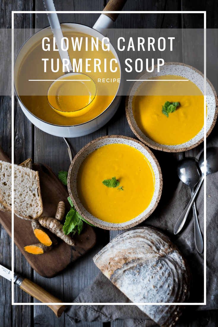 A delicious, healthy recipe for Glowing Carrot Ginger Turmeric Soup with Coconut Milk and ginger. Fresh turmeric and mint gives this soup its exotic flavor. Vegan. | www.feastingathome.com