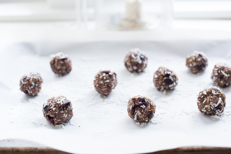 Coconut Pecan Energy Balls with Masala Spice and Dried Cranberries, a simple, tasty vegan and gluten-free snack that can be made in 10 minutes! | www.feastingathome.com