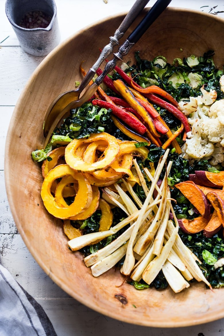 Roasted Veggie Salad over Kale and Brussel Slaw with a Curry Maple vinaigrette. Delicious an healthy! PLUS 20 CLEAN EATING RECIPES that are all vegan and GF adaptable! #vegan #plantbased #healthyrecipes #veganrecipes #wholefoods #eatclean #detox #cleaneating #roastedveggies #fallsalad #vegansalad #healthysalad