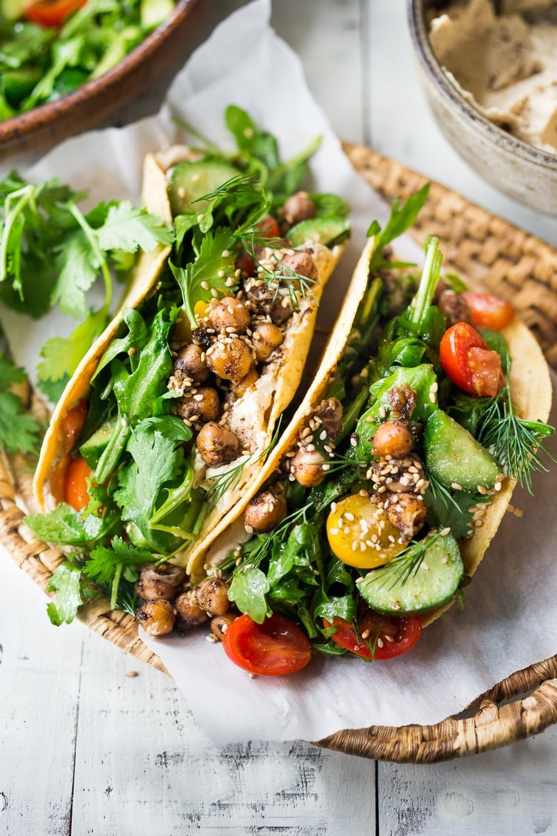 40 Mouthwatering Vegan Dinner Recipes!| Middle Eastern Salad Tacos with spiced chickpeas, hummus and a mound of lemony salad, topped with fresh herbs and scallions. Vegan & sooooo Delicious! | #plantbased #cleaneating #saladtacos #detox #veganrecipes #eatclean #healthy #healthyrecipes #healthylunchideas #tacos #vegantacos |www.feastingathome.com