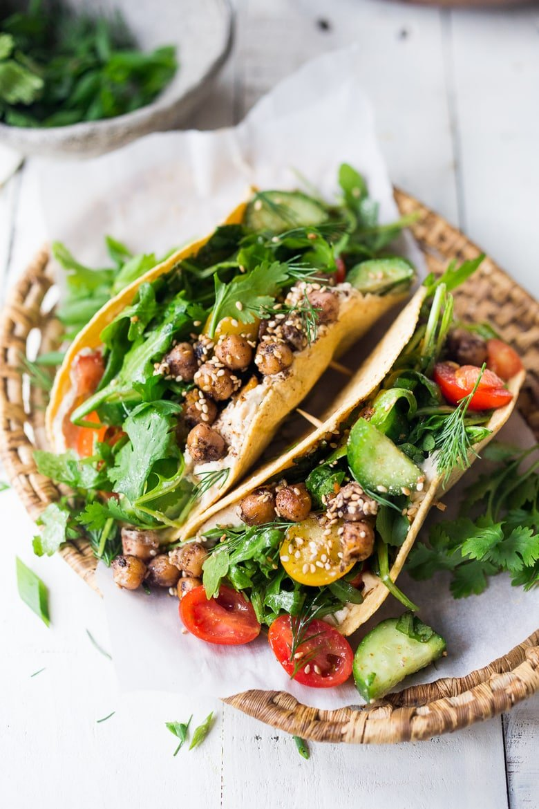 20 Healthy Chickpea Recipes! Like these Middle Eastern Salad Tacos with spiced chickpeas, hummus and a mound of lemony salad, topped with fresh herbs and scallions. Vegan & sooooo Delicious! | www.feastingathome.com