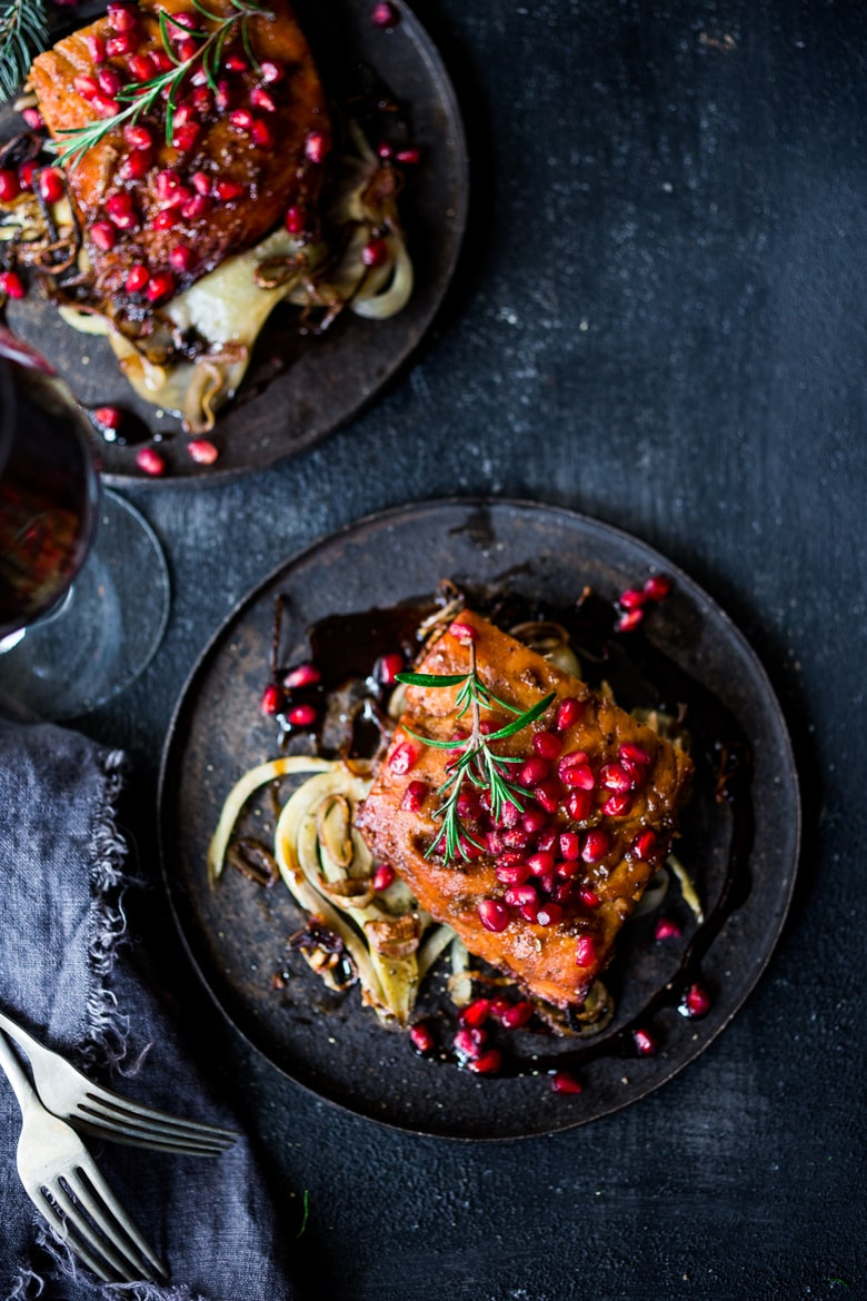 Roasted Pomegranate Salmon with braised fennel - a healthy and festive holiday dinner that can be made in under 30 minutes. | #pomegranate #salmon #bakedsalmon #fennel www.feastingathome.com