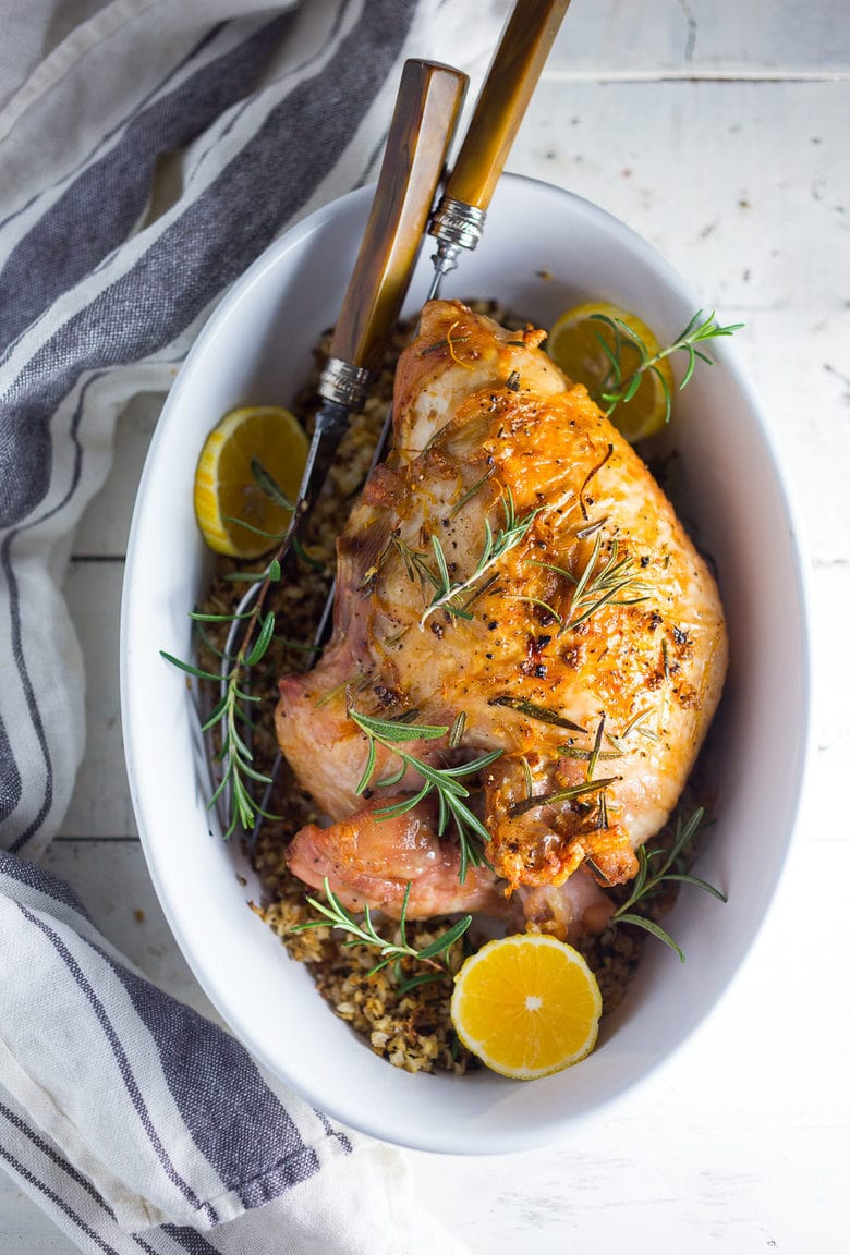 Simple Roast Turkey Breast seasoned with fragrant Rosemary and Meyer Lemon, then baked over riced cauliflower. A deliciously healthy recipe- paleo & GF!