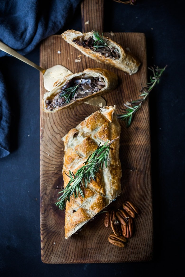 Mushroom Wellington with Rosemary and Pecans- a simple, elegant vegan main dish, that can be made ahead, perfect for Thanksgiving or Christmas! | www.feastingathome.com #mushroomwellington #vegan #thanksgivingrecipevegan #veganmain #veganthanksgiving #veganchristmas #veganmaindish #veganrecipe