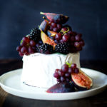 Simple, beautiful Brie Cake topped with fresh berries, figs and grapes, drizzled with honey and served with seeded crackers - an easy, festive appetizer or dessert, perfect for celebrations and gatherings.   www.feastingathome.com