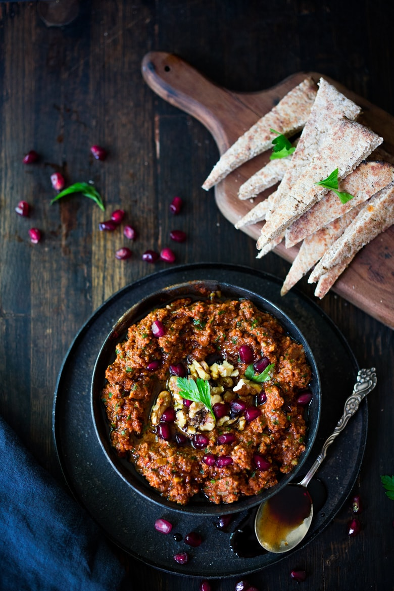 How to make Muhammara Dip - a flavorful Middle Eastern appetizer made with roasted peppers and walnuts. A delicious dip to serve with veggies or pita bread! #Muhammara #muhammaradip