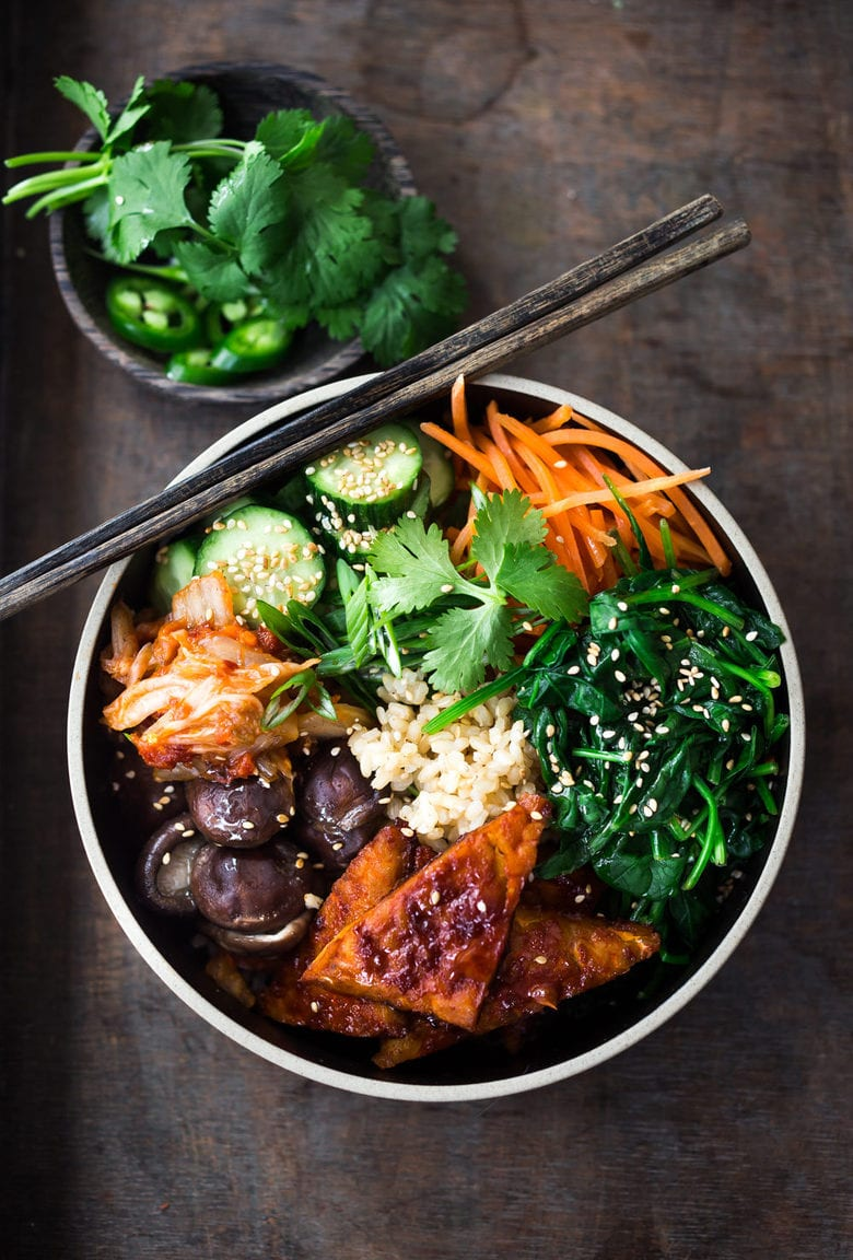 Korean-Style Seoul Bowl ( Bibimbap!)  with Gochujang baked Tempeh, steamed veggies, kimchi and pickled cucumber- a healthy vegan version of Bibimbap!