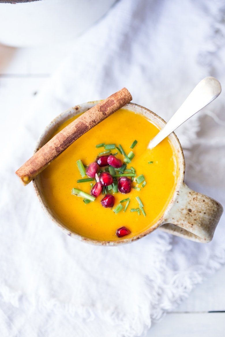 20 Mouthwatering VEGETARIAN Soups Recipes for FALL! Simple, delicious Moroccan Carrot Soup with Ginger, Coconut milk, fresh orange juice and warming Moroccan Spices. Vegan and Gluten-free. Bright & cheery! #carrotsoup #moroccancarrotsoup #vegansoup #gingercarrotsoup
