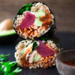Delicious and healthy Sushi Burrito- filled with veggies, kimchi and your choice of ahi, tofu or smoked salmon. GF and Vegan adaptable | www.feastingathome.com