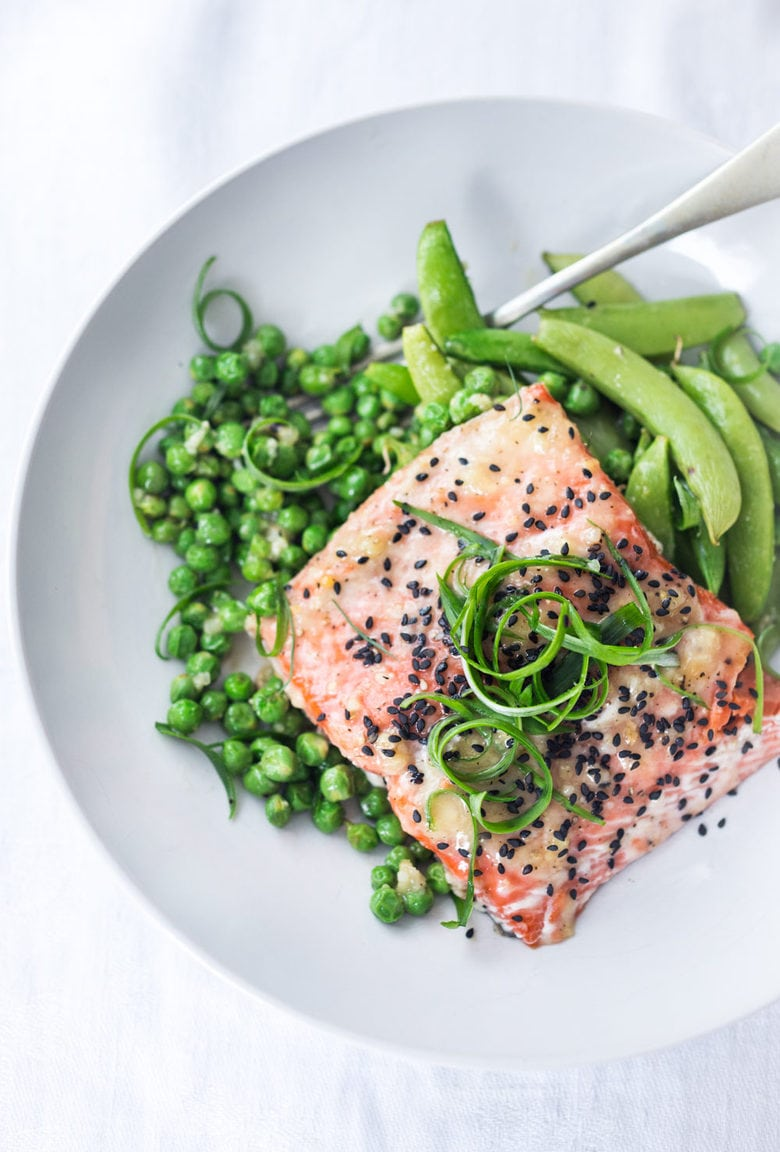 Here's a simple recipe for Sheet Pan Miso Salmon and Spring Peas - a fast and healthy weeknight dinner that can be made in under 25 minutes.