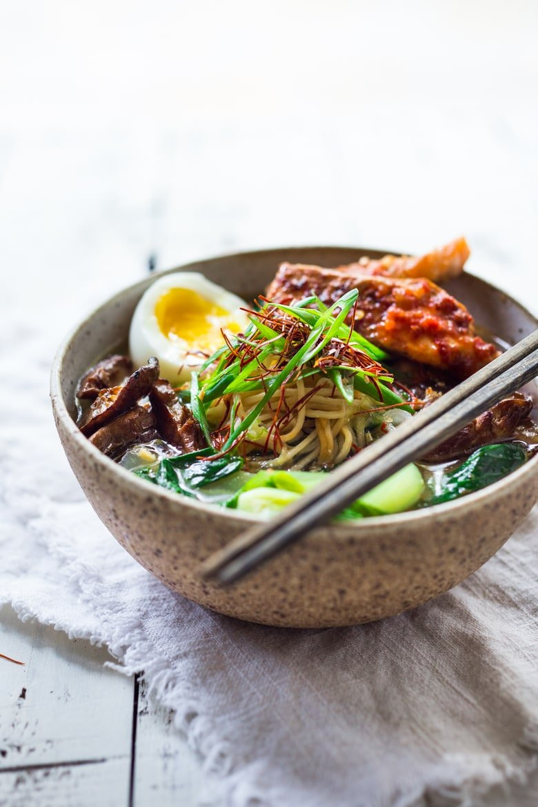 Spicy Miso Ramen with Roasted Chili Salmon ( or tofu!) with bok choy, mushrooms and scallions. Vegan and Paleo adaptable! Swap out zucchini noodles or kelp noodles to keep it Paleo! | www.feastingathome.com