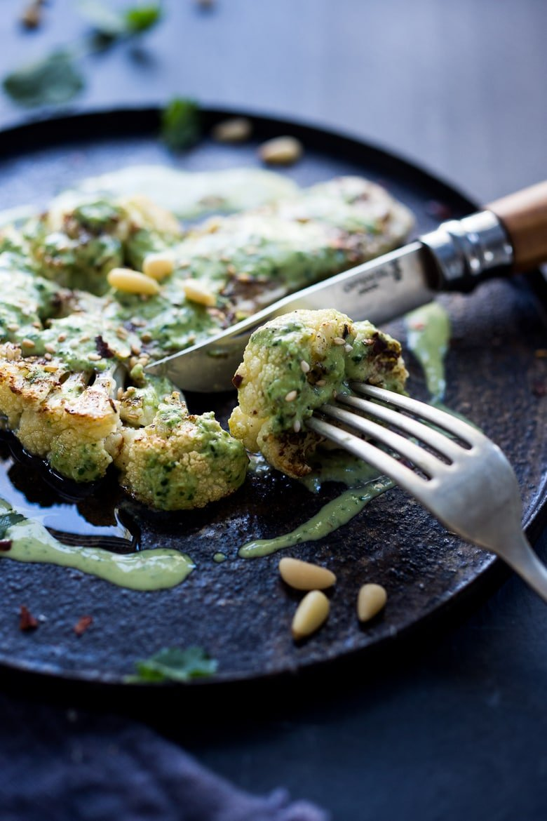 Zaatar Roasted Cauliflower Steaks with Green Tahini Sauce - a simple delicious vegan meal full of Middle Eastern flavor that can be made in 35 minutes.| www.feastingathome.com