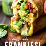 Introducing the FRANKIE! India's flavorful street food (aka Bombay Burrito) that you will fall in love with!!! This vegan version is bursting with flavor- filled with curry mashed potatoes, roasted Indian cauliflower and chickpeas, fresh spinach, mint chutney and pickled onions.| #frankie #frankies #bombayburrito #vegan #veganburrito #indianburrito #indianfood #streetfood